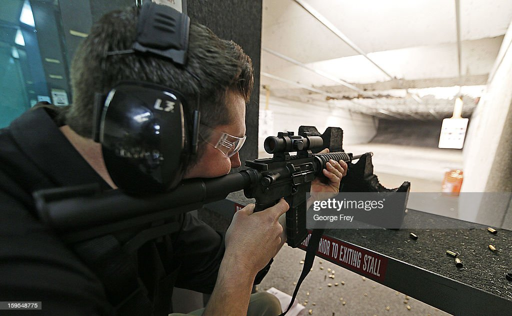 Brett Nielsen fires an AR-15 rifle at the 'Get Some Guns & Ammo' shooting range on January 15, 2013 in Salt Lake City, Utah. Lawmakers are calling for tougher gun legislation after recent mass shootings at an Aurora, Colorado movie theater and at Sandy Hook Elementary School in Newtown, Connecticut.