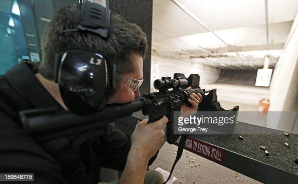 Brett Nielsen fires an AR15 rifle at the 'Get Some Guns Ammo' shooting range on January 15 2013 in Salt Lake City Utah Lawmakers are calling for...