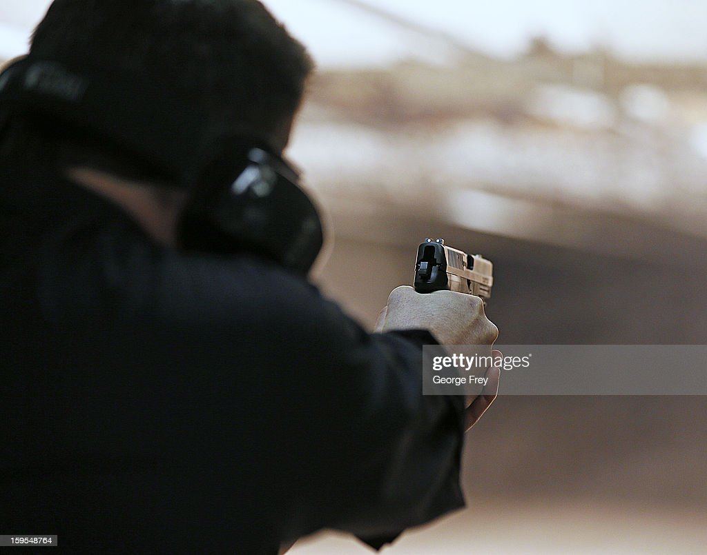 Brett Nielsen fires an Glock handgun at the 'Get Some Guns & Ammo' shooting range on January 15, 2013 in Salt Lake City, Utah. Lawmakers are calling for tougher gun legislation after recent mass shootings at an Aurora, Colorado movie theater and at Sandy Hook Elementary School in Newtown, Connecticut.