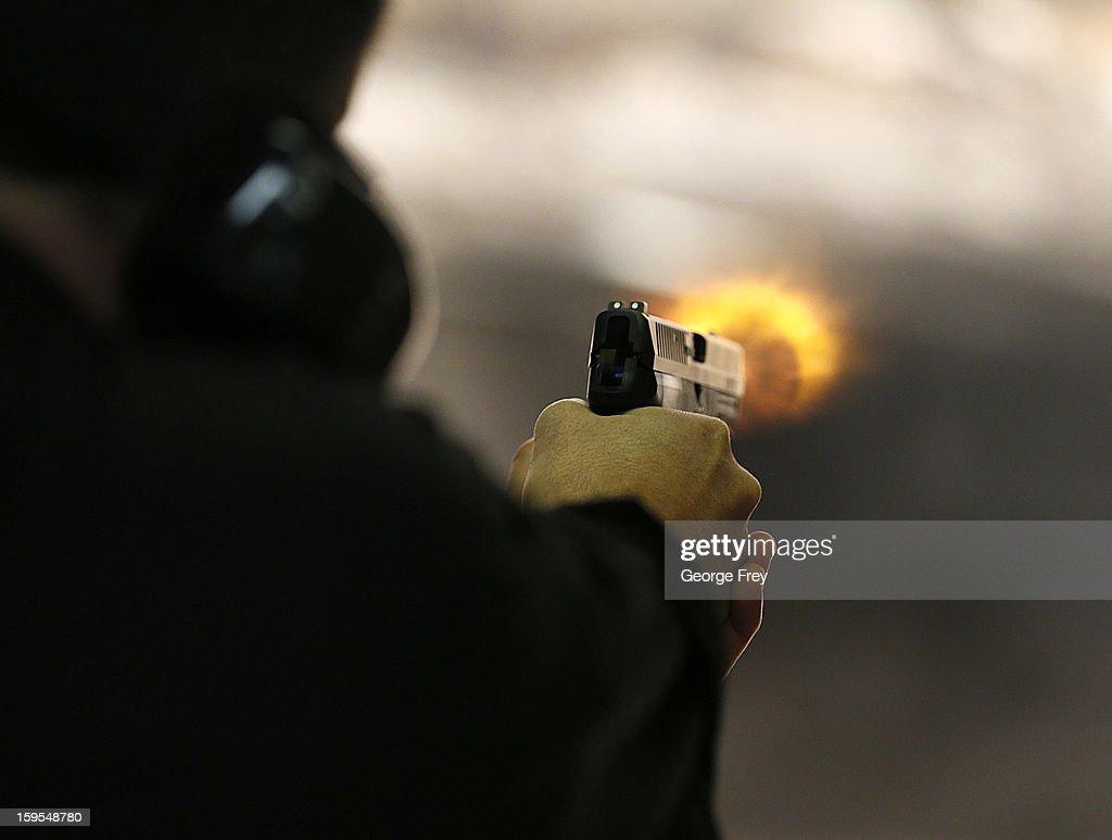 Brett Nielsen fires an Glock handgun at the 'Get Some Guns Ammo' shooting range on January 15 2013 in Salt Lake City Utah Lawmakers are calling for...