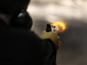 Brett Nielsen fires an Glock handgun at the 'Get Some Guns Ammo' shooting range on January 15 2013 in Salt Lake City Utah Lawmakers are calling for...