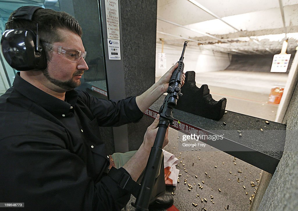 Brett Nielsen prepares to fire an AR-15 rifle at the 'Get Some Guns & Ammo' shooting range on January 15, 2013 in Salt Lake City, Utah. Lawmakers are calling for tougher gun legislation after recent mass shootings at an Aurora, Colorado movie theater and at Sandy Hook Elementary School in Newtown, Connecticut.