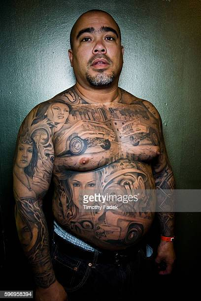 Brett Olague displays his tattoos at the 12th Annual New York City Tattoo Convention at Roseland Ballroom in Manhattan