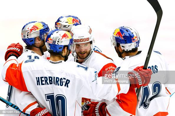Brett Olson of Red Bull Salzburg celebrates scoring goal 02 together with his team during the Champions Hockey League match between HV71 Jonkoping...