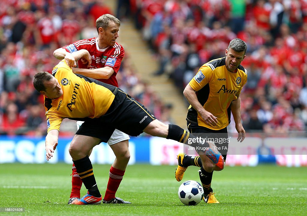 Brett Ormerod of Wrexham battles with Michael Flynn of Newport County during the Conference Premier play-off final match between Wrexham and Newport County at Wembley Stadium on May 5, 2013 in London, England.