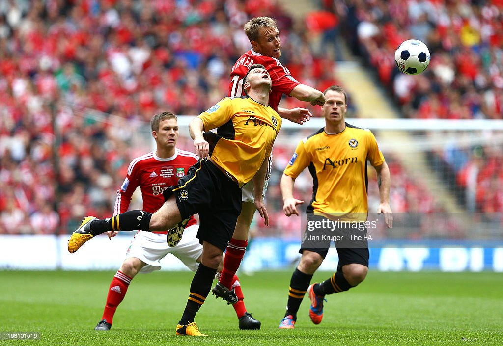 Brett Ormerod of Wrexham battles with Tony James of Newport County during the Conference Premier play-off final match between Wrexham and Newport County at Wembley Stadium on May 5, 2013 in London, England.