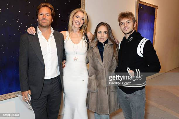 Brett Palos Stasha Palos Chloe Green and Brandon Green attend a private view of 'And The Stars Shine Down' by Stasha Palos at the Saatchi Gallery on...