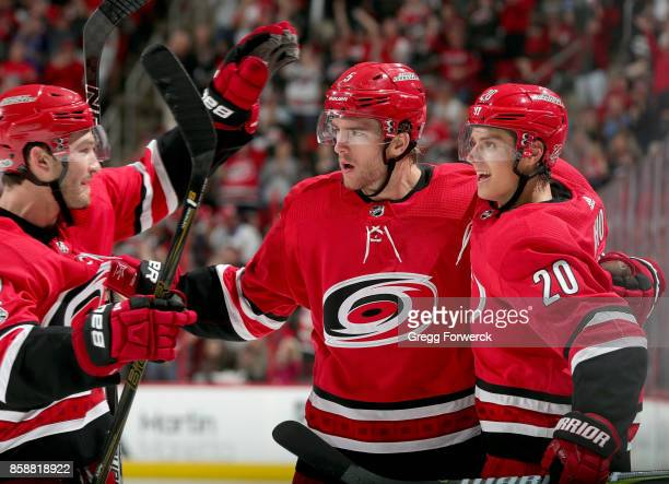 Brett Pesce and Sebastian Aho of the Carolina Hurricanes celebrate a thirdperiod goal scored by Noah Hanifin against the Minnesota Wild during an NHL...