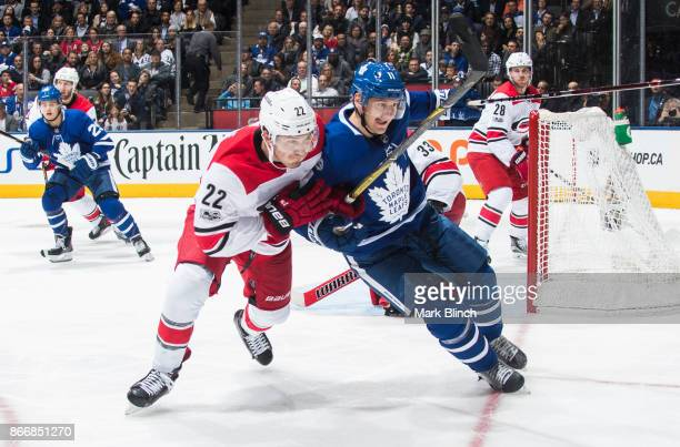 Brett Pesce of the Carolina Hurricanes battles for position against Zach Hyman of the Toronto Maple Leafs during the third period at the Air Canada...
