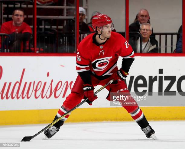 Brett Pesce of the Carolina Hurricanes controls a puck on the ice during an NHL game against the St Louis Blues on October 27 2017 at PNC Arena in...