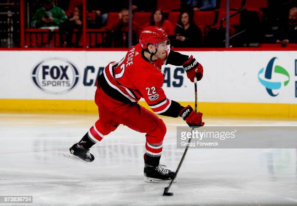 Brett Pesce of the Carolina Hurricanes fires a slap shot during an NHL game against the Dallas Stars on November 13 2017 at PNC Arena in Raleigh...