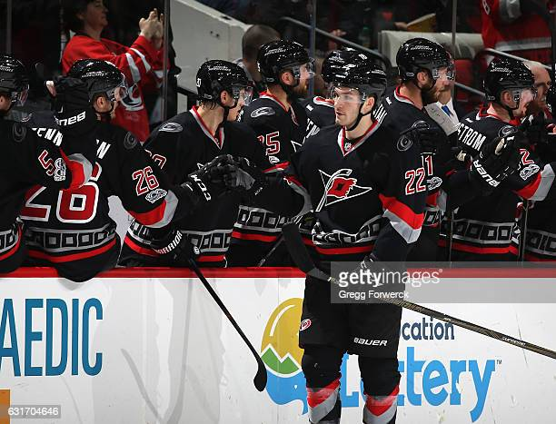 Brett Pesce of the Carolina Hurricanes is congratulated by teammates after scoring a second period goal during an NHL game against the New York...