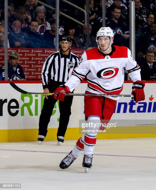 Brett Pesce of the Carolina Hurricanes keeps an eye on the play during first period action against the Winnipeg Jets at the Bell MTS Place on October...