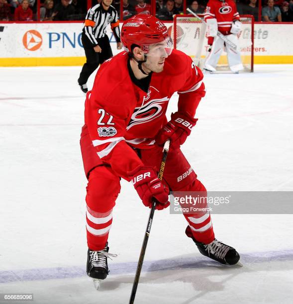 Brett Pesce of the Carolina Hurricanes looks to pass a puck during an NHL game against the New York Islanders on March 14 2017 at PNC Arena in...