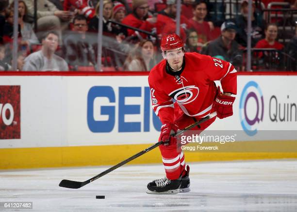 Brett Pesce of the Carolina Hurricanes moves the puck on the ice during an NHL game against the Edmonton Oilers on February 3 2017 at PNC Arena in...