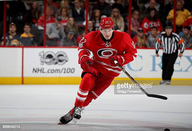 Brett Pesce of the Carolina Hurricanes skates for a loose puck during an NHL game against the Buffalo Sabres on January 13 2017 at PNC Arena in...