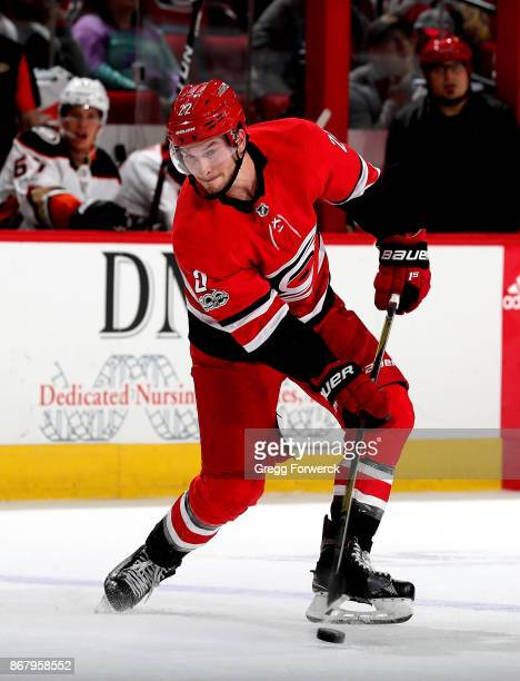 Brett Pesce of the Carolina Hurricanes skates with the puck during an NHL game against the Anaheim Ducks on October 29 2017 at PNC Arena in Raleigh...