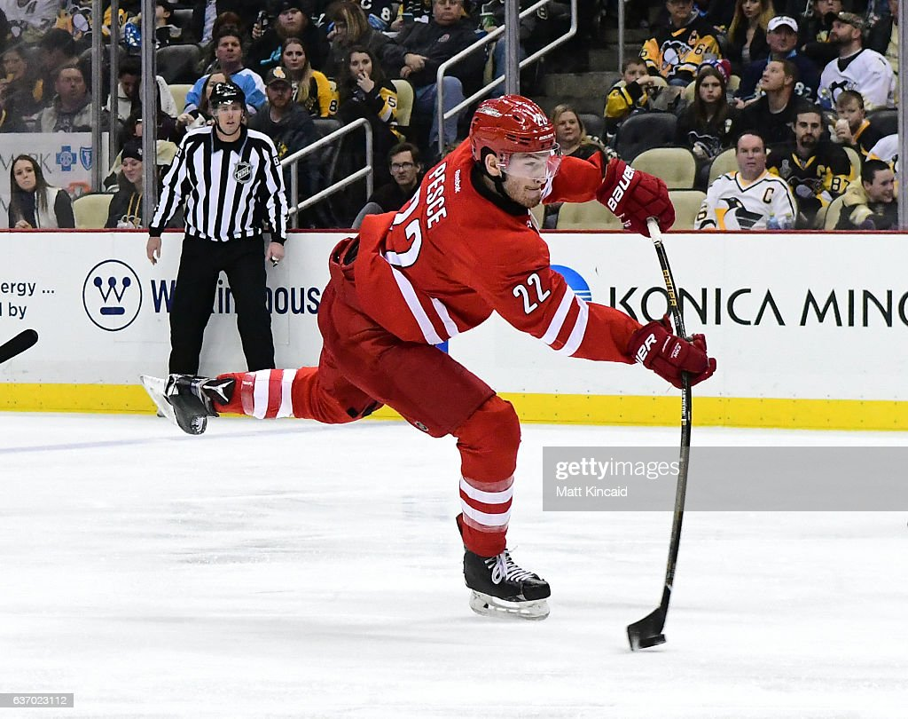 Brett Pesce #22 of the Carolina Hurricanes takes a slap shot against the Pittsburgh Penguins at PPG PAINTS Arena on December 28, 2016 in Pittsburgh, Pennsylvania.