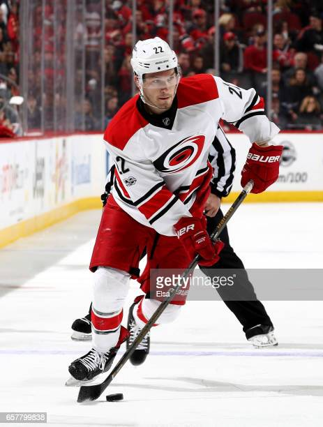 Brett Pesce of the Carolina Hurricanes takes the puck in the third period against the New Jersey Devils on March 25 2017 at Prudential Center in...