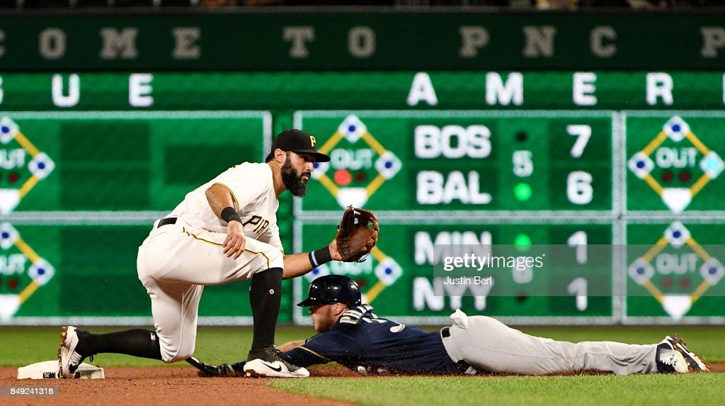 Brett Phillips #33 of the Milwaukee Brewers slides safely into second base under a tag attempt by Sean Rodriguez #3 of the Pittsburgh Pirates in the seventh inning during the game at PNC Park on September 18, 2017 in Pittsburgh, Pennsylvania.