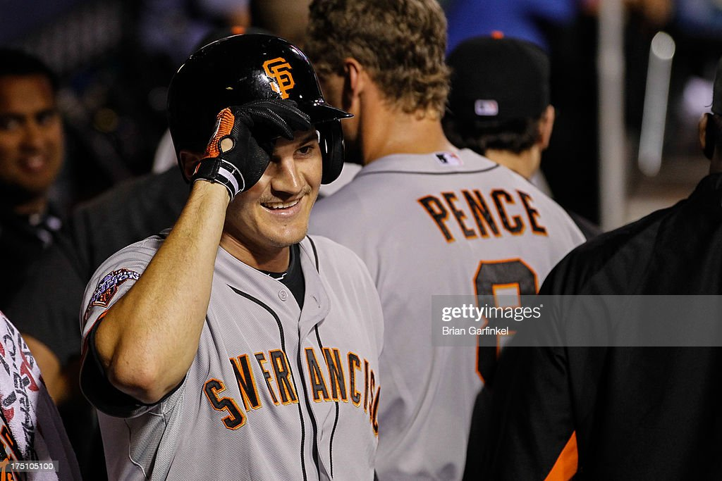 Brett Pill #6 of the San Francisco Giants smiles in the dugout after hitting a solo home run in the seventh inning of the game against the Philadelphia Phillies at Citizens Bank Park on July 31, 2013 in Philadelphia, Pennsylvania. The Giants won 9-2.