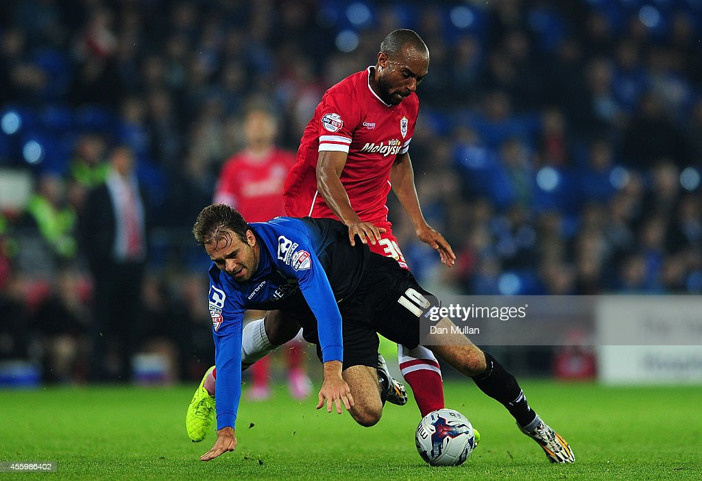 Brett Pitman of Bournemouth is fouled by Daniel Gabbidon of Cardiff City during the Capital One Cup third round match between Cardiff City and Bournemouth at Cardiff City Stadium on September 23, 2014 in Cardiff, Wales.