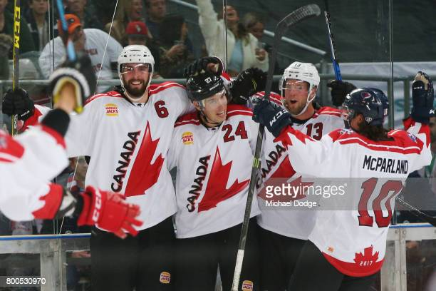 Brett Ponich Adam Cracknell and Peter Holland of Canada celebrate winning the series after a sudden death goal by Adam Cracknell during the Ice...