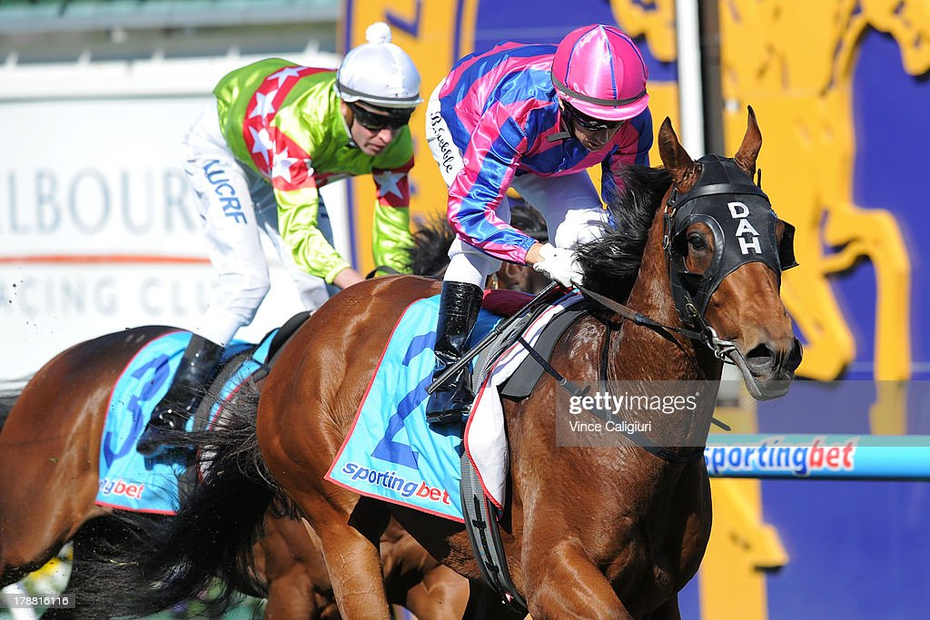 <a gi-track='captionPersonalityLinkClicked' href=/galleries/search?phrase=Brett+Prebble&family=editorial&specificpeople=646298 ng-click='$event.stopPropagation()'>Brett Prebble</a> riding Fast'n'Rocking defeats Steven Arnold riding Prince Harada in the H.D.F.McNeill Stakes during Melbourne racing at Caulfield Racecourse on August 31, 2013 in Melbourne, Australia.