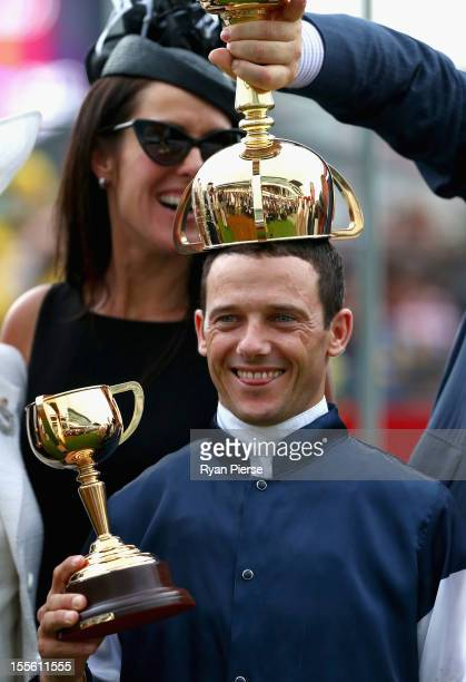 Brett Prebble riding Green Moon celebrates after winning the Emirates Melbourne Cup race during 2012 Melbourne Cup Day at Flemington Racecourse on...