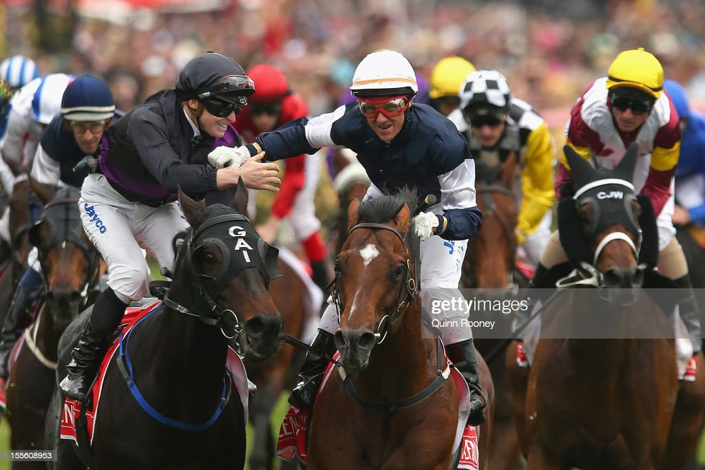 Brett Prebble riding Green Moon is congratulated by James McDonald riding Fiorente after winning the Emirates Melbourne Cup during 2012 Melbourne Cup Day at Flemington Racecourse on November 6, 2012 in Melbourne, Australia.