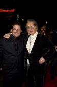 Brett Ratner director and Robert Evans during After the Sunset Los Angeles Premiere Red Carpet at Chinese Theatre in Hollywood California United...