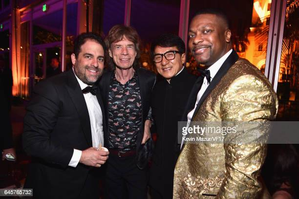 Brett Ratner Mick Jagger Jackie Chan and Chris Tucker attend the 2017 Vanity Fair Oscar Party hosted by Graydon Carter at Wallis Annenberg Center for...