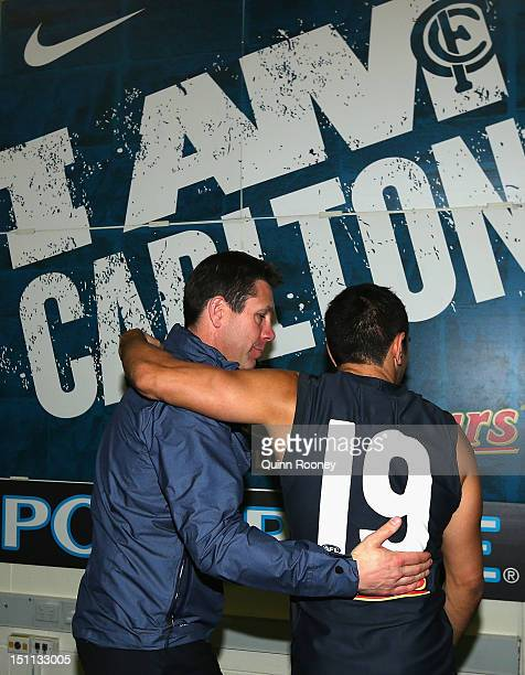Brett Ratten the coach of the Blues hugs Eddie Betts in the rooms after being defeated by the Saints during the round 23 AFL match between the...