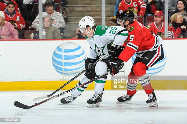 Brett Ritchie of the Dallas Stars and David Rundblad of the Chicago Blackhawks chase the puck during the NHL game at the United Center on January 4...