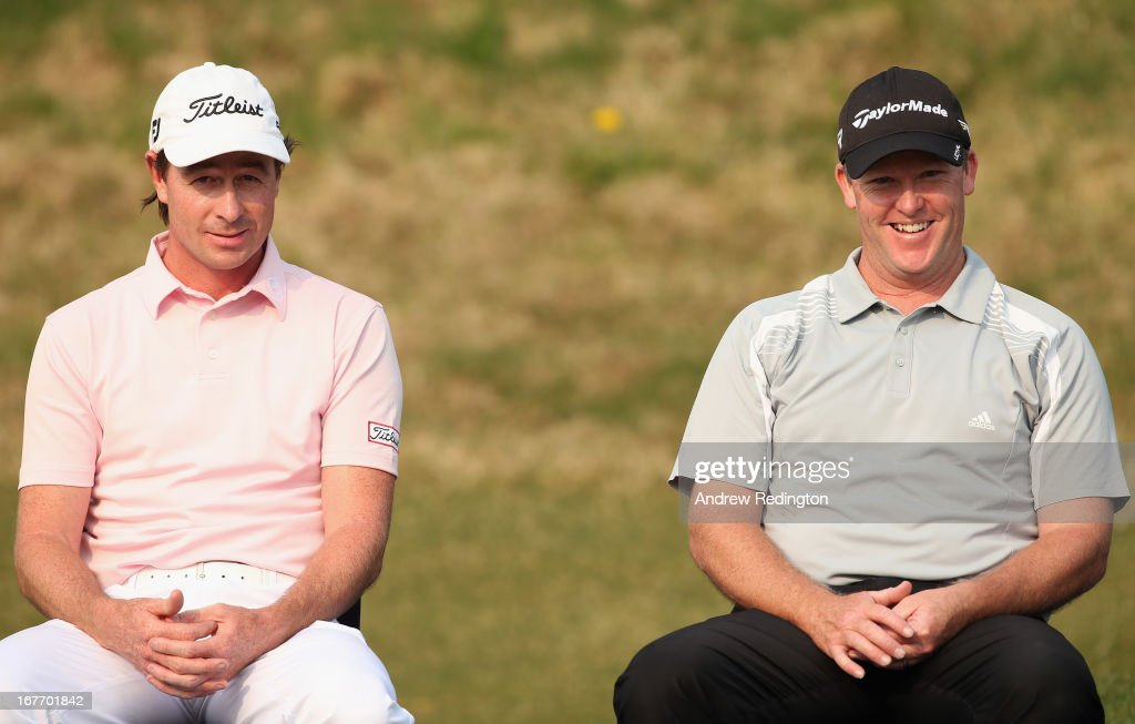 Brett Rumford and Marcus Fraser (both of Australia ) share a joke during the prize-giving for the Ballantine's Championship at Blackstone Golf Club on April 28, 2013 in Icheon, South Korea.