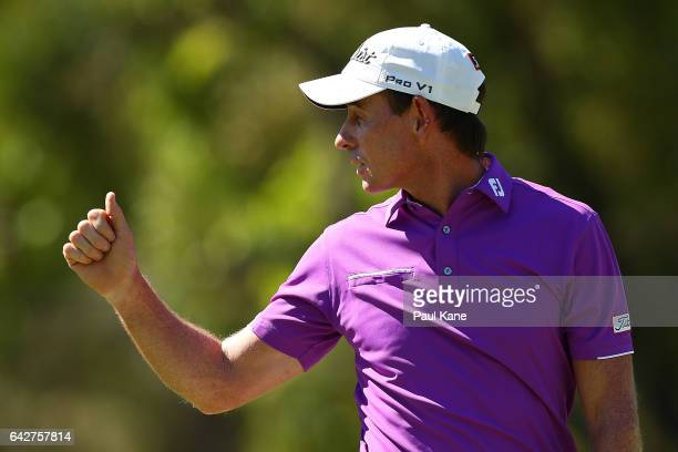 Brett Rumford of Australia acknowledges the gallery after defeating Hideto Tanihara of Japan in match nine of the match play during round four of the...
