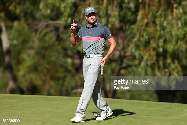 Brett Rumford of Australia acknowledges the gallery on the 18th green after completing his round during round two of the ISPS HANDA World Super 6...