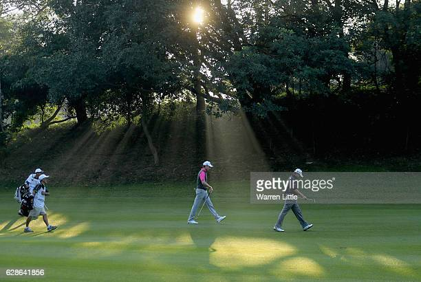 Brett Rumford of Australia and Adilson Da Silva of Brazil walk up the second fairway during the second round of the USB Hong Kong Open at The Hong...