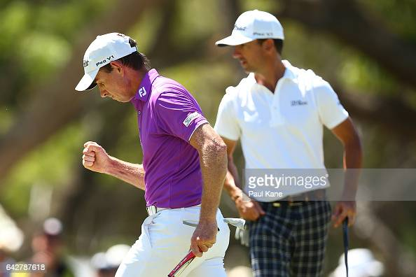 Brett Rumford of Australia celebrates after a birdie putt on the shoot out hole in match seventeen of the match play during round four of the ISPS...