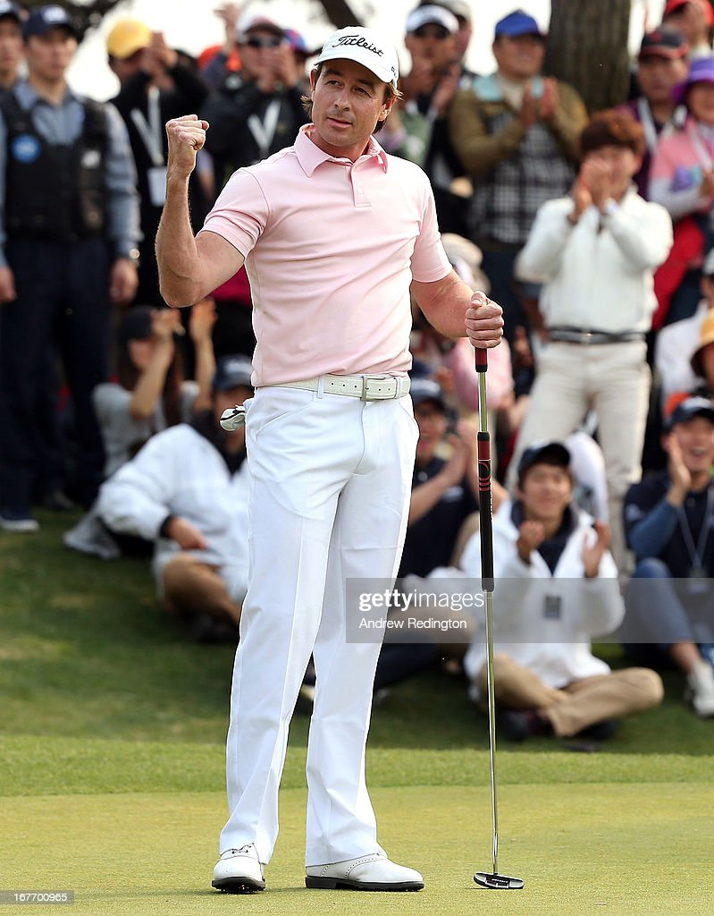 Brett Rumford of Australia celebrates after holing an eagle putt at the first play-off hole to win the play-off and the Ballantine's Championship at Blackstone Golf Club on April 28, 2013 in Icheon, South Korea.