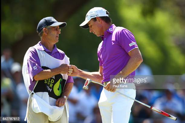 Brett Rumford of Australia celebrates with his caddie after a birdie putt on the shoot out hole in match seventeen of the match play during round...