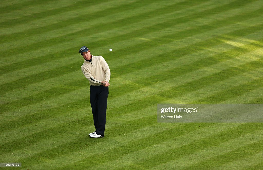 <a gi-track='captionPersonalityLinkClicked' href=/galleries/search?phrase=Brett+Rumford&family=editorial&specificpeople=216614 ng-click='$event.stopPropagation()'>Brett Rumford</a> of Australia chips onto the 18th green during the first round of the BMW PGA Championship on the West Course at Wentworth on May 23, 2013 in Virginia Water, England.