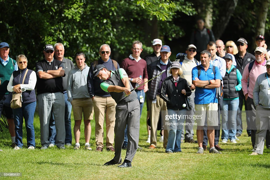 <a gi-track='captionPersonalityLinkClicked' href=/galleries/search?phrase=Brett+Rumford&family=editorial&specificpeople=216614 ng-click='$event.stopPropagation()'>Brett Rumford</a> of Australia hits his 2nd shot on the 4th hole during day one of the BMW PGA Championship at Wentworth on May 26, 2016 in Virginia Water, England.
