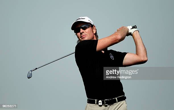 Brett Rumford of Australia hits his second shot on the ninth hole during the second round of the Commercialbank Qatar Masters at Doha Golf Club on...
