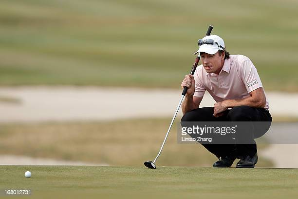 Brett Rumford of Australia lines up a putt during the third day of the Volvo China Open at Binhai Lake Golf Course on May 4 2013 in Tianjin China