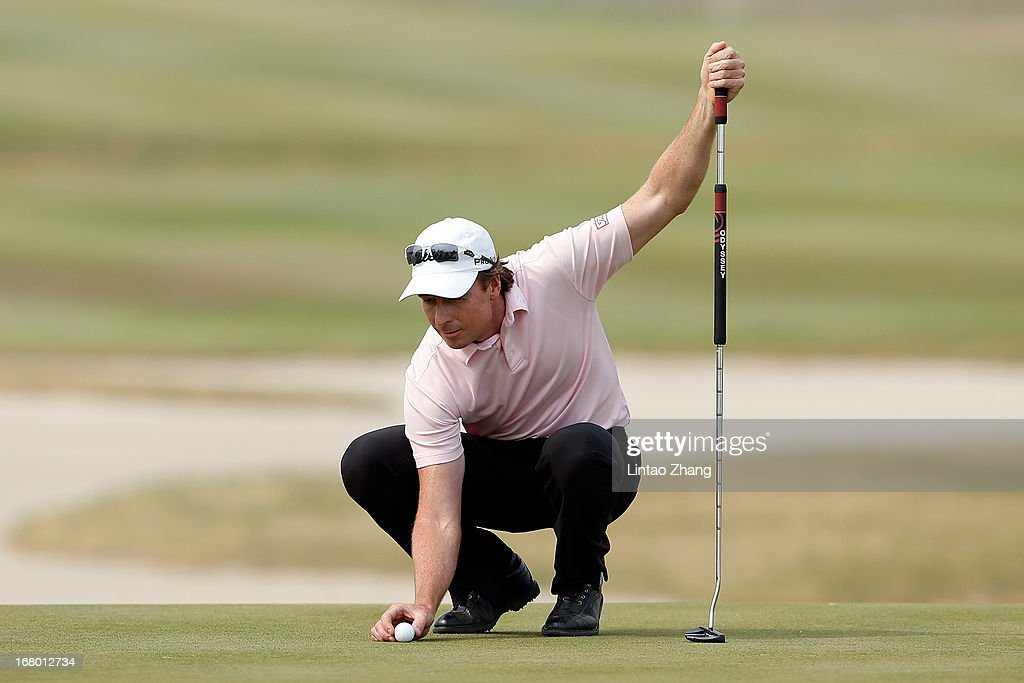 Brett Rumford of Australia lines up a putt during the third day of the Volvo China Open at Binhai Lake Golf Course on May 4, 2013 in Tianjin, China.