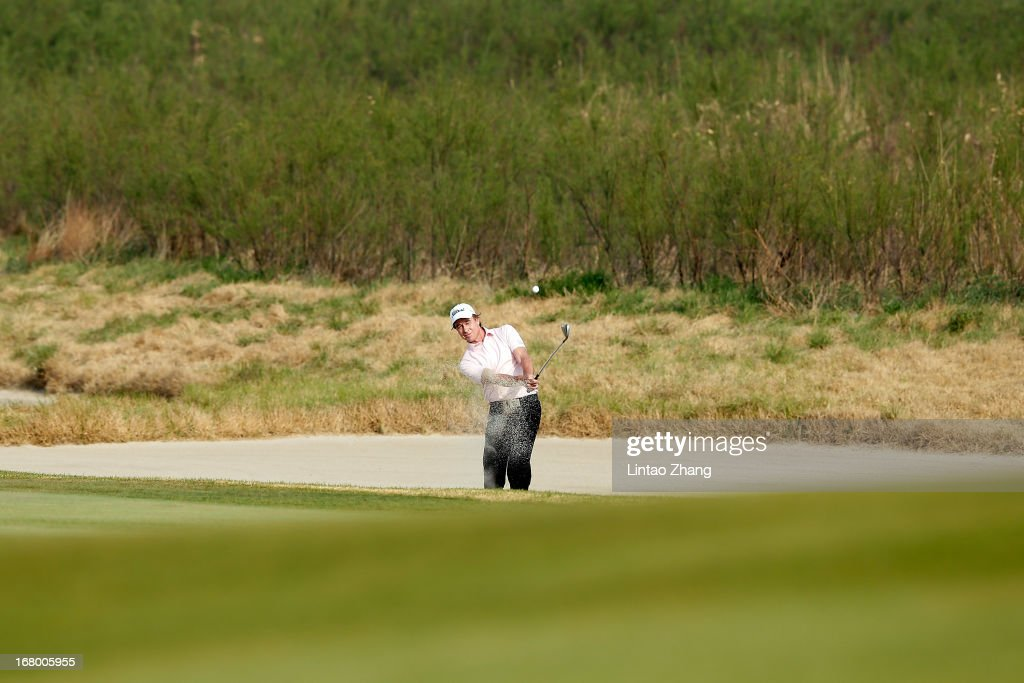 <a gi-track='captionPersonalityLinkClicked' href=/galleries/search?phrase=Brett+Rumford&family=editorial&specificpeople=216614 ng-click='$event.stopPropagation()'>Brett Rumford</a> of Australia plays a shot during the third day of the Volvo China Open at Binhai Lake Golf Course on May 4, 2013 in Tianjin, China.