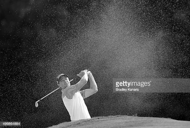 Brett Rumford of Australia plays a shot out of the bunker on the 18th hole during day two of the 2015 Australian PGA Championship at Royal Pines...