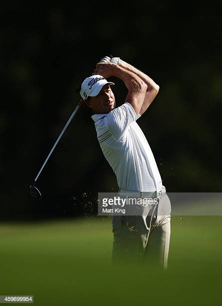 Brett Rumford of Australia plays an approach shot on the 18th hole during day three of the Australian Open at The Australian Golf Course on November...