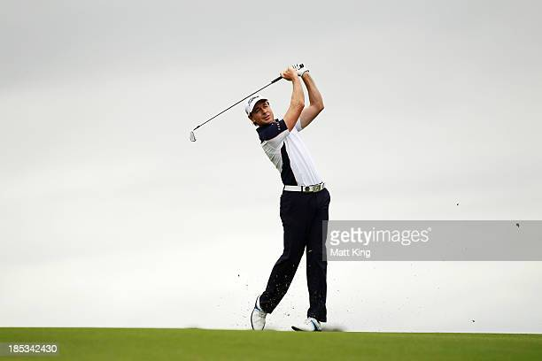 Brett Rumford of Australia plays his approach shot on the 18th hole during day three of the Perth International at Lake Karrinyup Country Club on...